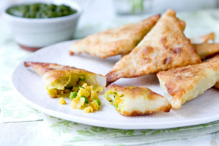 These shortcut vegetarian Samosas with Mint Chutney are filled with potatoes, peas and lentils and ready in under 45 minutes.