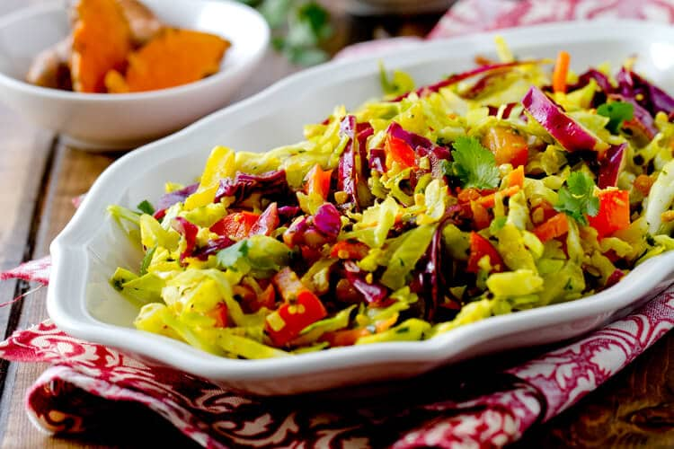 Indian spiced coleslaw with fresh turmeric, coconut, lime, chilis and cilantro