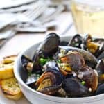 This Quick Mussels with White Wine, Garlic and Herb sauce recipe is ready in under 15 minutes Perfect for weeknights and for entertaining!