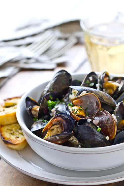 Bowl of steamed mussels with white wine and herb butter
