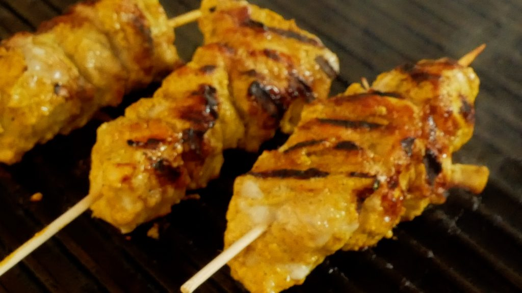 Murgh Tikka or Chicken Tikka on a grill.