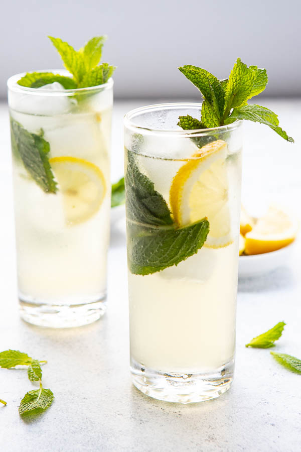 two glasses with gin and ginger ale cocktail.